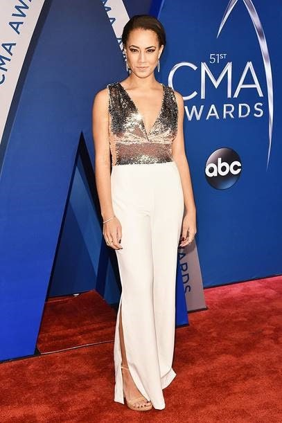 84ed407671 The Access Hollywood correspondent sparkled on the red carpet in Mixed  Sequin Split-Hem Jumpsuit ( 169