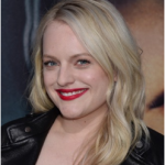 Elisabeth Moss Seen Recently Wearing City Beauty City Lips in Red Velvet opaque plumping lip gloss