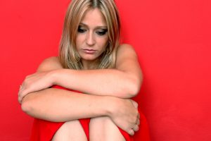 beautiful sad woman on the red background